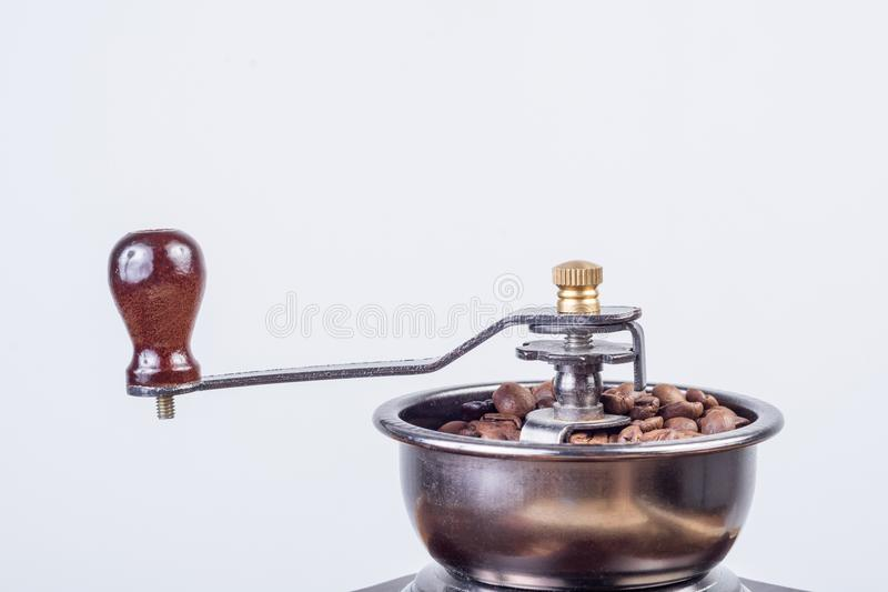 Retro coffee mill with roasted coffee beans isolated on white background stock photos