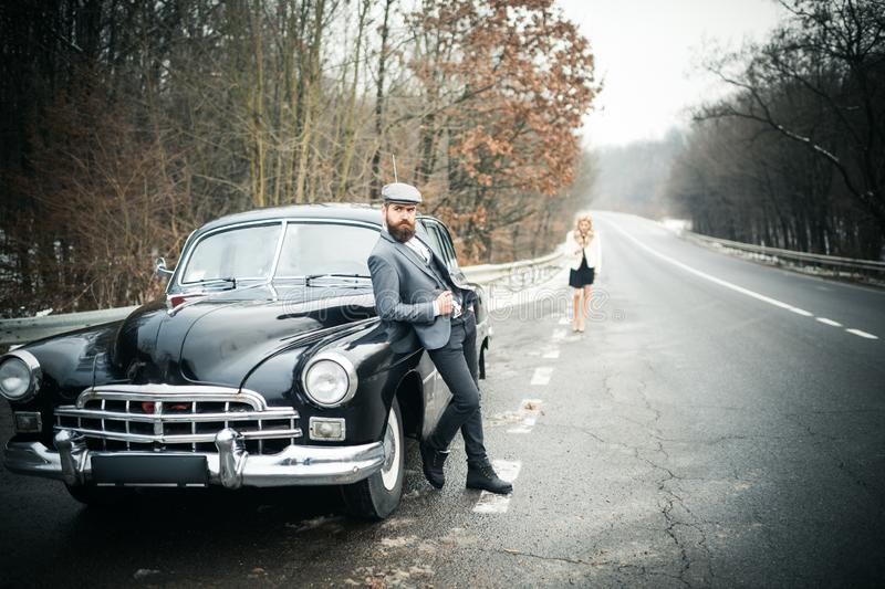 Retro collection car and auto repair by mechanic driver. Couple in love on romantic date. Travel and business trip or stock photography