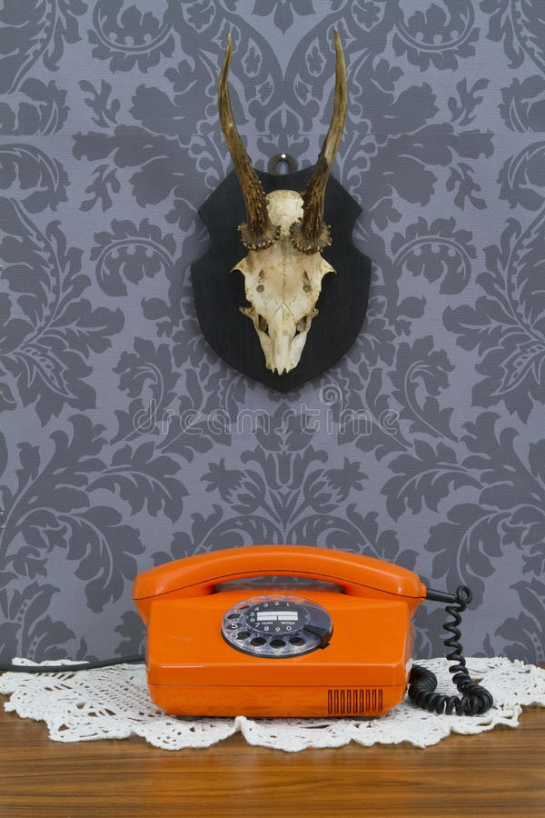 Download Retro Communication On Floral Wallpaper And Antler Stock Photo - Image: 26269908