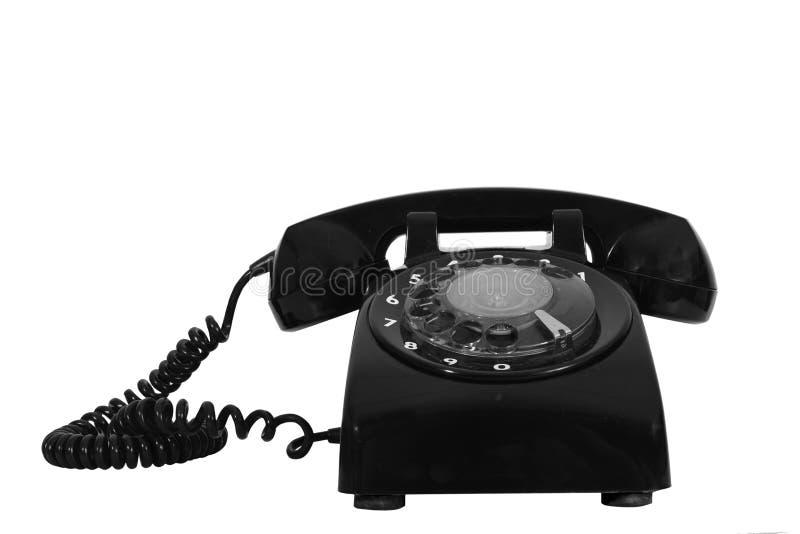 Retro dial style black house telephone. Classic 1970 - 1980 retro dial style black house telephone stock photos