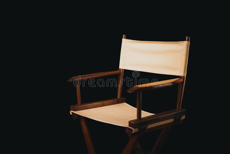 Retro director chair on black. Vintage director chair on a black background royalty free stock photography
