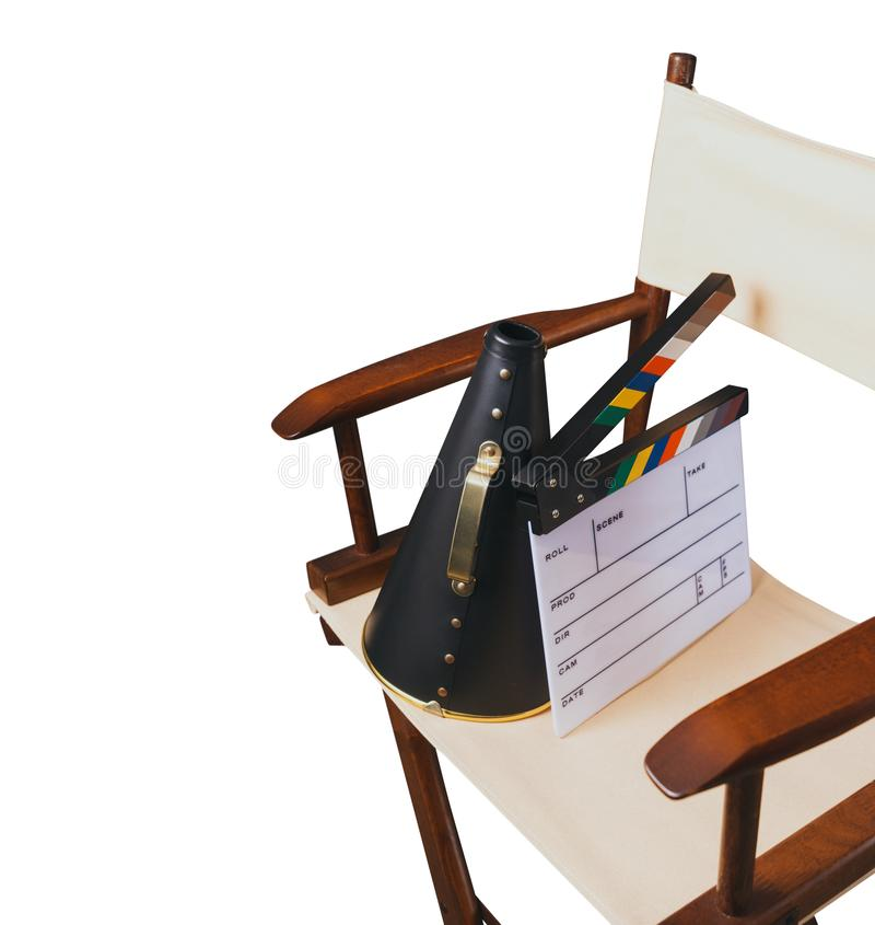 Retro director chair on white. Vintage director chair with megaphone and movie clapper isolated on white stock image