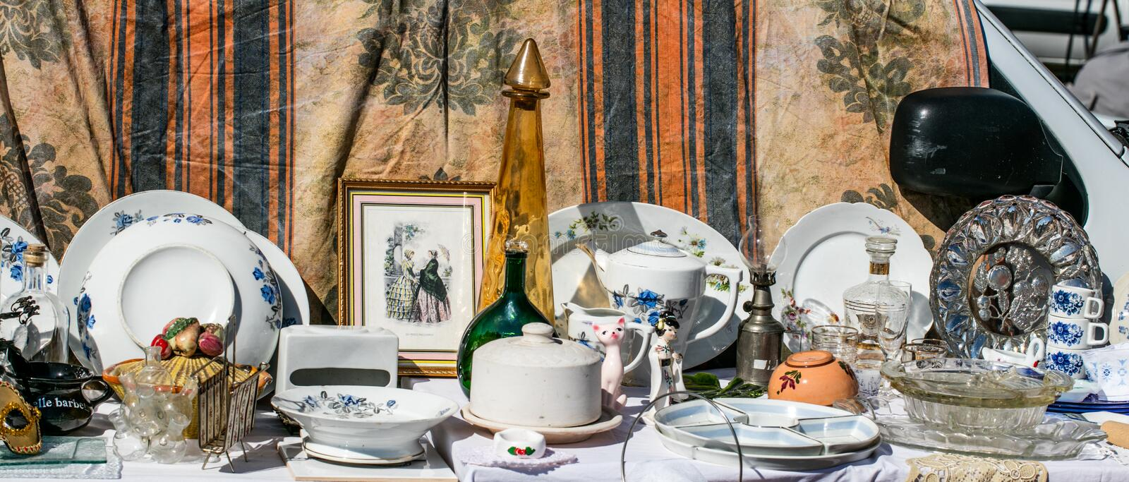 Retro display of household things and dishes at garage sale. Retro display of household things, various decoration objects and dishes at garage sale for second royalty free stock images