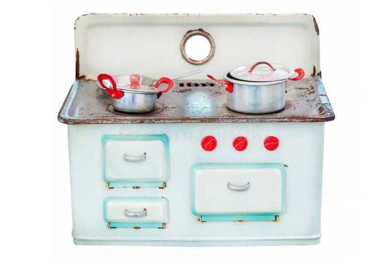 Retro doll house cooking stove isolated on white. Vintage doll house cooking stove with pans isolated on a white background stock photo