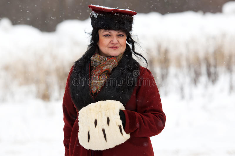Retro dressed woman posing. RUSSIA, APRELEVKA - FEBRUARY 7: Unidentified woman in retro costume posing on reenactment of the Napoleonic maneuvers near the stock images