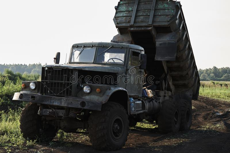 Retro dump truck on a quarry with a raised body.  stock photo