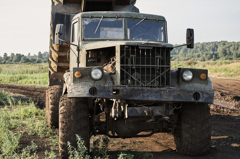 Retro dump truck on a quarry with a raised body.  royalty free stock images