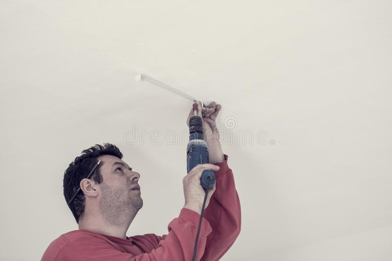Retro effect faded and toned image of electrician using an elect royalty free stock photo