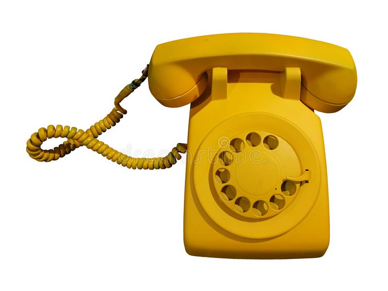 Retro en uitstekende gele roterende die telefoon op witte achtergrond met het Knippen van weg wordt geïsoleerd royalty-vrije stock fotografie