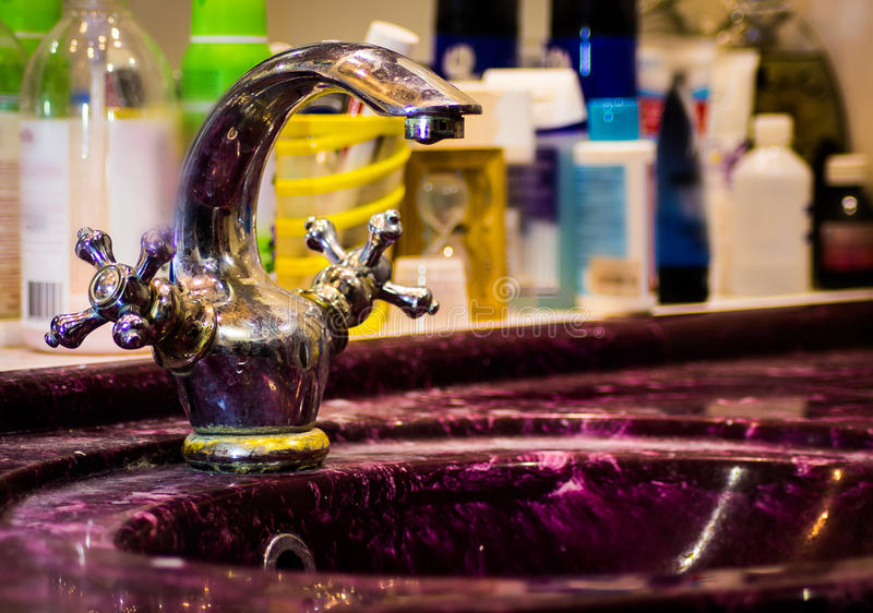Retro faucet in gold stock image