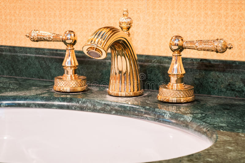 Retro faucet in gold. Luxury faucet mixer in a beautiful bathroom stock photo