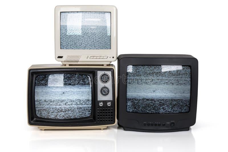 Retro- Fernsehstapel mit statischen Schirmen lizenzfreie stockfotografie