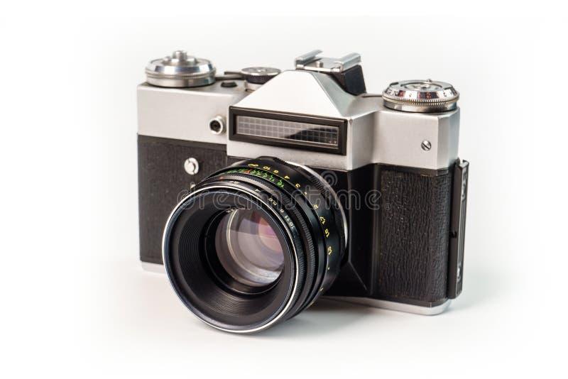Retro film photo camera isolated on white background. Old analog. Camera isolated on white background. Vintage design royalty free stock photo