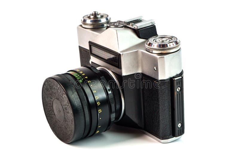 Retro film photo camera isolated on white background. Old analog royalty free stock image