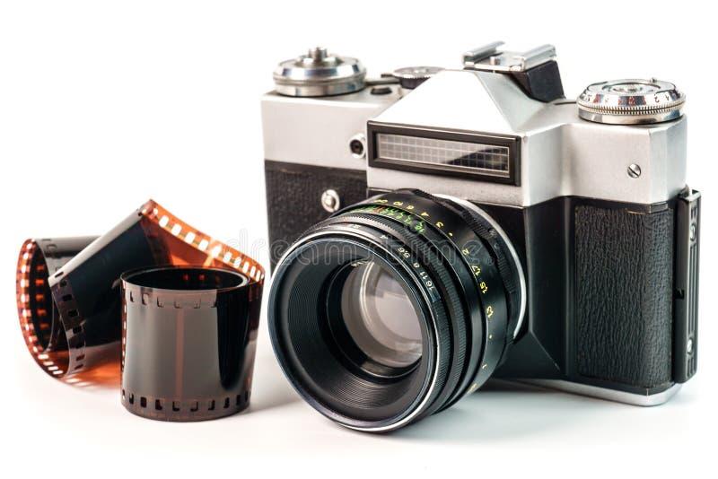 Retro film photo camera isolated on white background. Old analog. Camera and photo film isolated on white background. Vintage design royalty free stock photos
