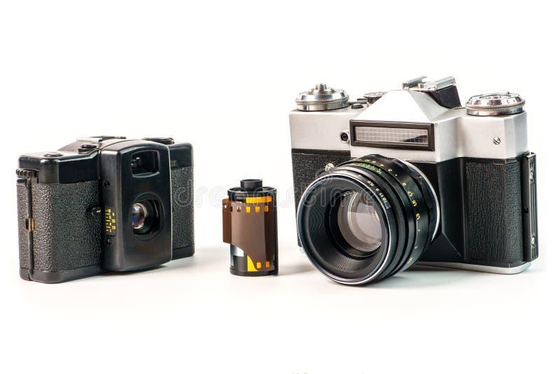Retro film photo camera isolated on white background. Old analog. Camera and photo film isolated on white background. Vintage design stock photo