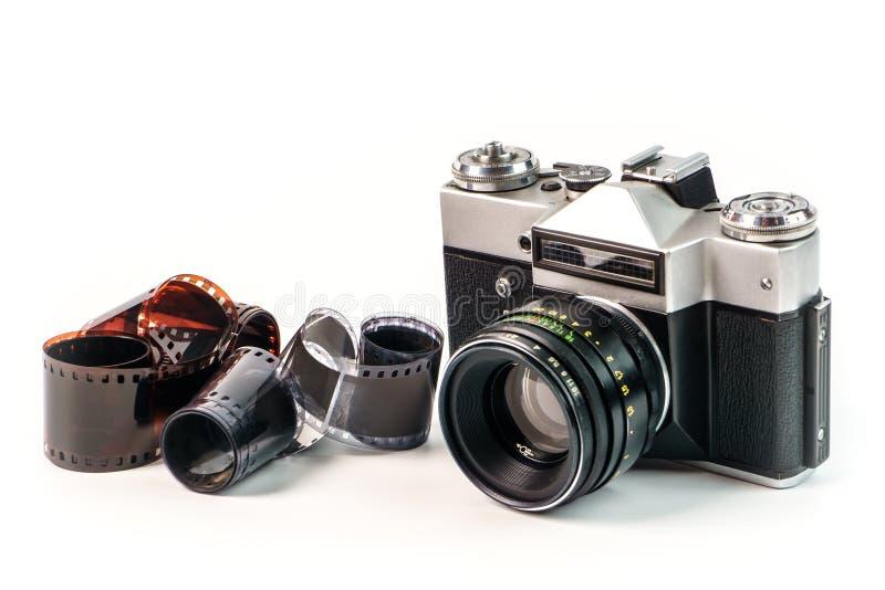Retro film photo camera on white background. Old analog. Camera and photo film isolated on white background. Vintage design royalty free stock photo