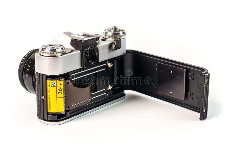 Retro film photo camera on white background. Old analog. Camera back door and photo film isolated on white background. Vintage design royalty free stock photos
