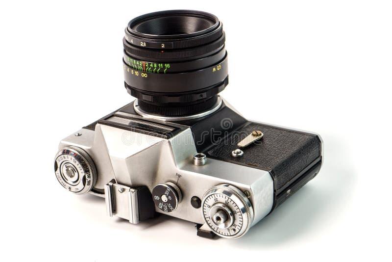 Retro- Filmfotokamera lokalisiert auf weißem Hintergrund Alte Entsprechung stockfotografie