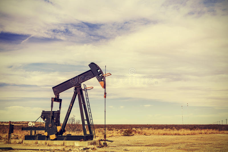 Retro filtered picture of oil pump jack, Texas, USA stock photography