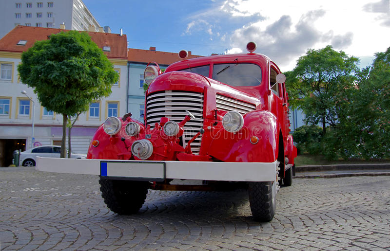 Retro fire truck. Front view of red firetruck. stock images