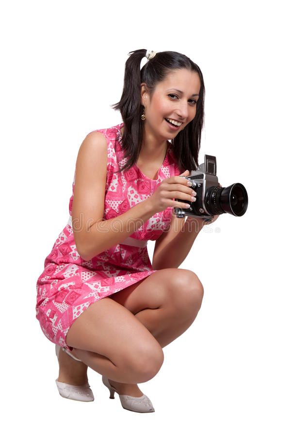 Retro flicka i en rosa klänning arkivbilder