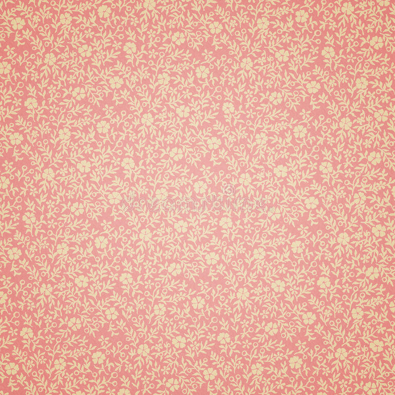 Retro Floral Wallpaper. Vintage wallpaper with yellow flowers on pink background royalty free stock photo