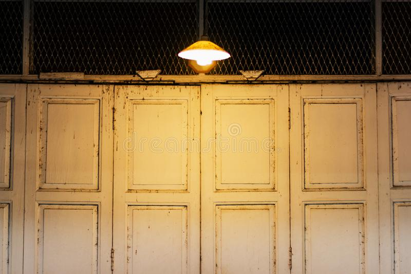 Retro folding door with light. In vintage style royalty free stock photos
