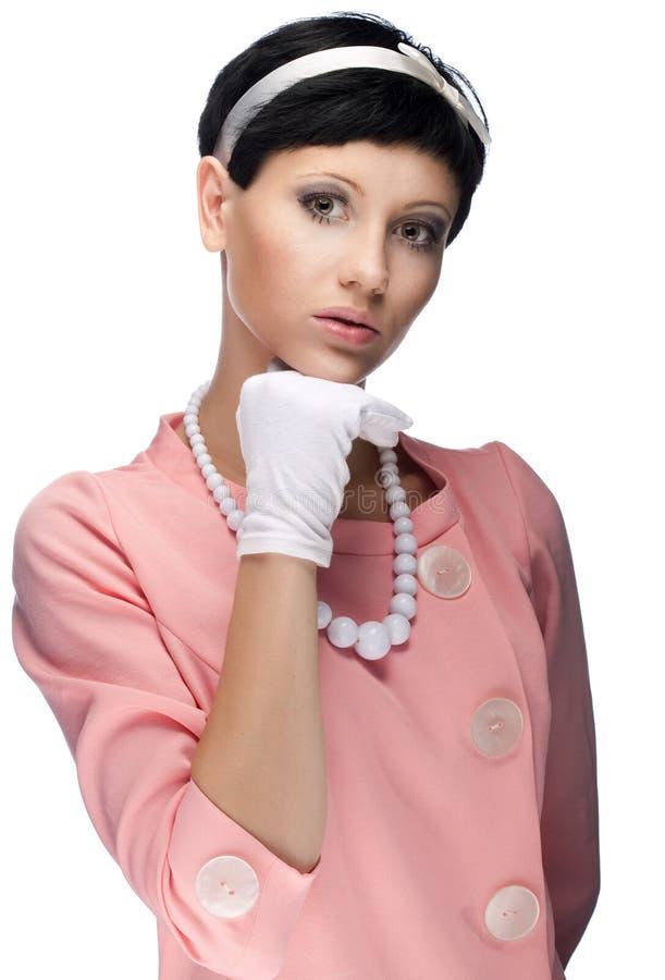 Retro- Frau Im Rosafarbenen Kleid 60s Stockbild