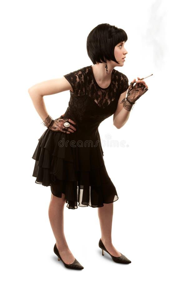Retro- Frau mit dem schwarzen Haar stockfoto
