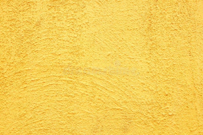 Retro- gelber Betonmauerhintergrund lizenzfreie stockbilder