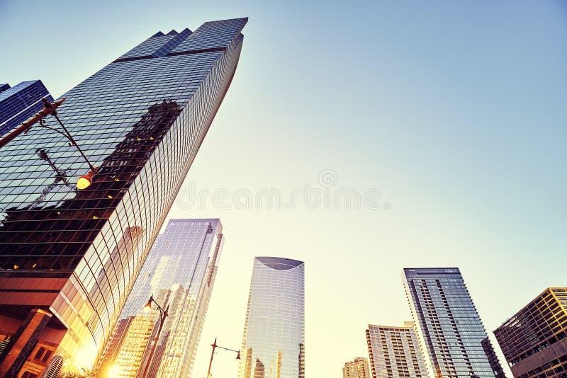 Retro gestemd Chicago de stad in bij zonsondergang, de V.S. stock fotografie