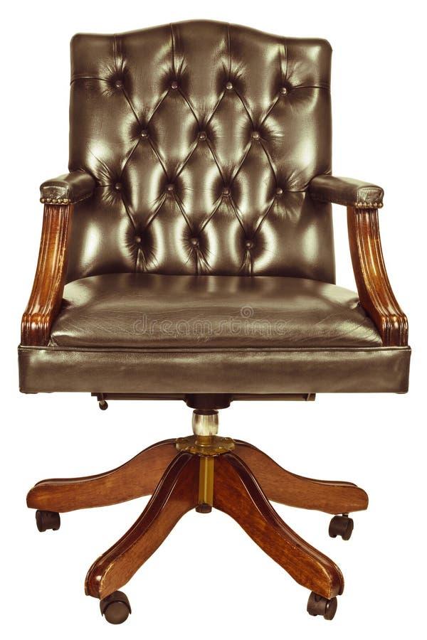 Retro gestileerd beeld van een klassieke die bureaustoel op wit wordt geïsoleerd stock foto