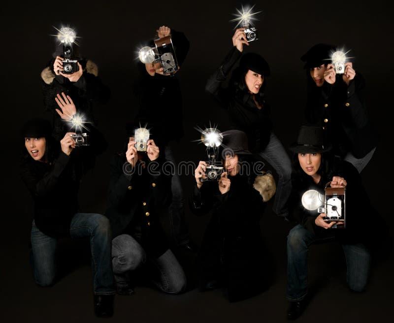 Retro giornalisti fotografici dei paparazzi di stile fotografia stock libera da diritti