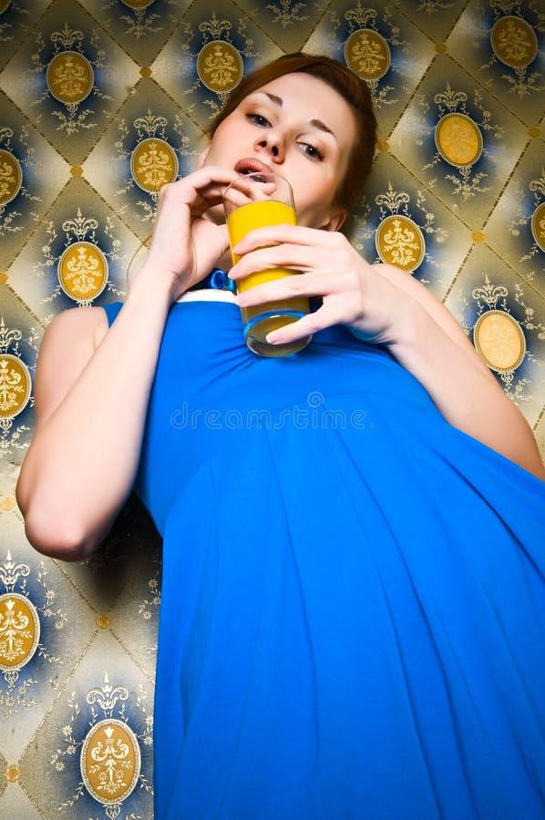 Retro Girl In Blue Dress With Orange Juice Royalty Free Stock Photo