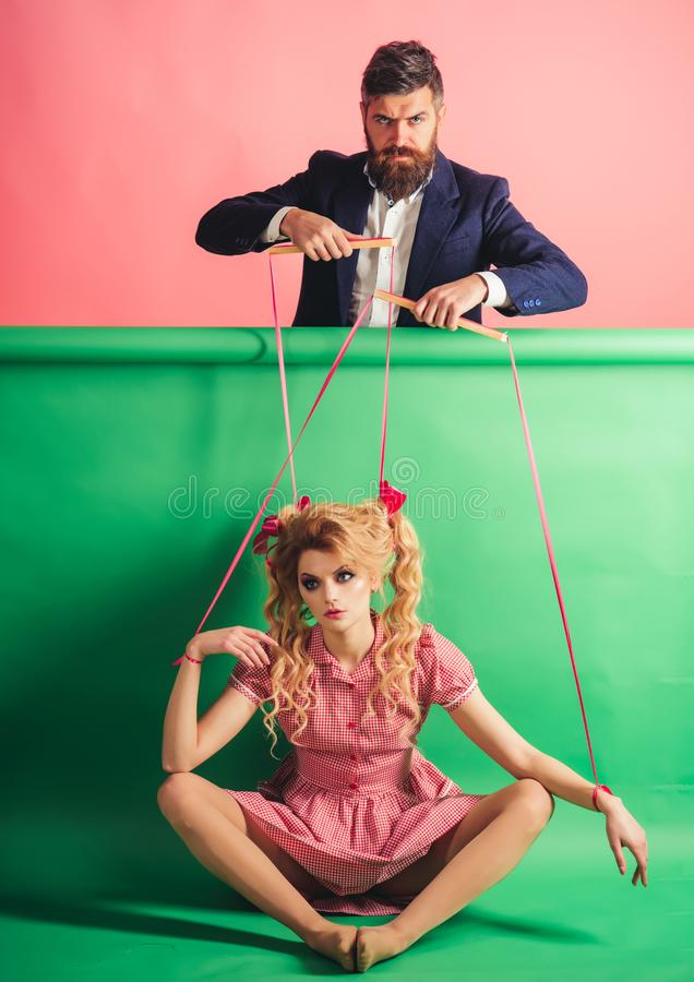 Retro girl and master in party. vintage fashion woman puppet and man. Creative idea. Love. Crazy girs and man on pink. Retro girl and master in party. vintage royalty free stock image