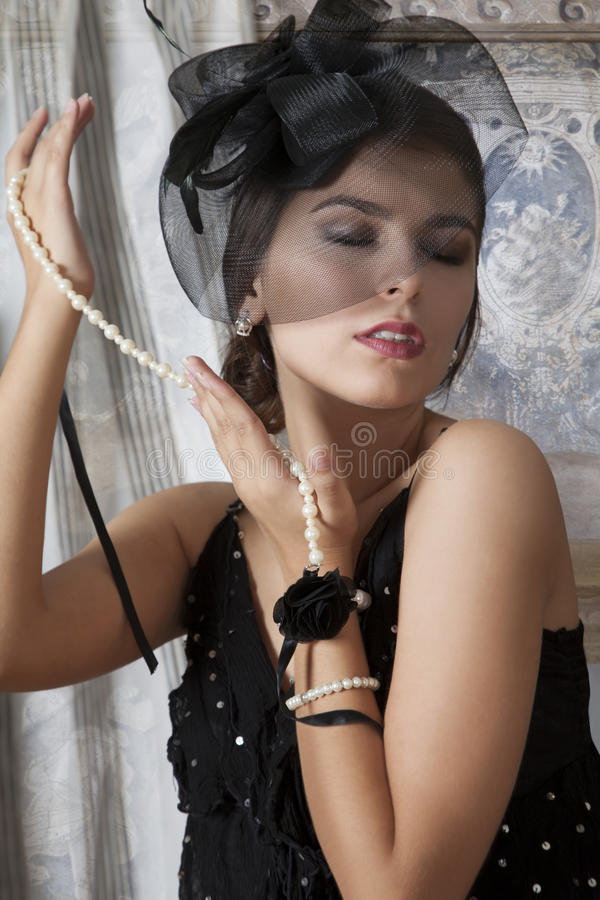 Retro girl with pearl necklace royalty free stock photography