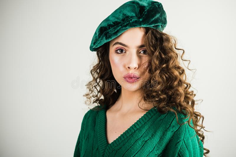 Retro girl with stylish makeup and hair in paris. Fashion woman in green sweater. Fashion look and beauty concept stock photography