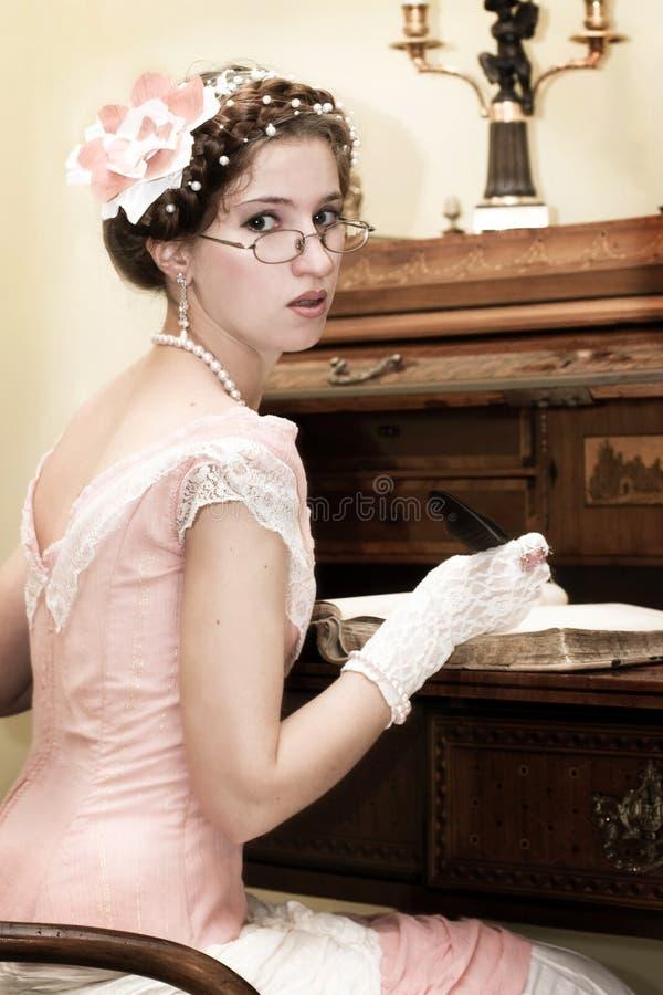 Retro Girl Writing Royalty Free Stock Photo