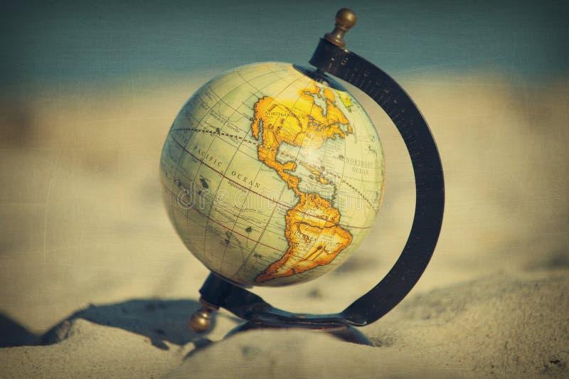 Retro- globaler Strand lizenzfreie stockfotografie