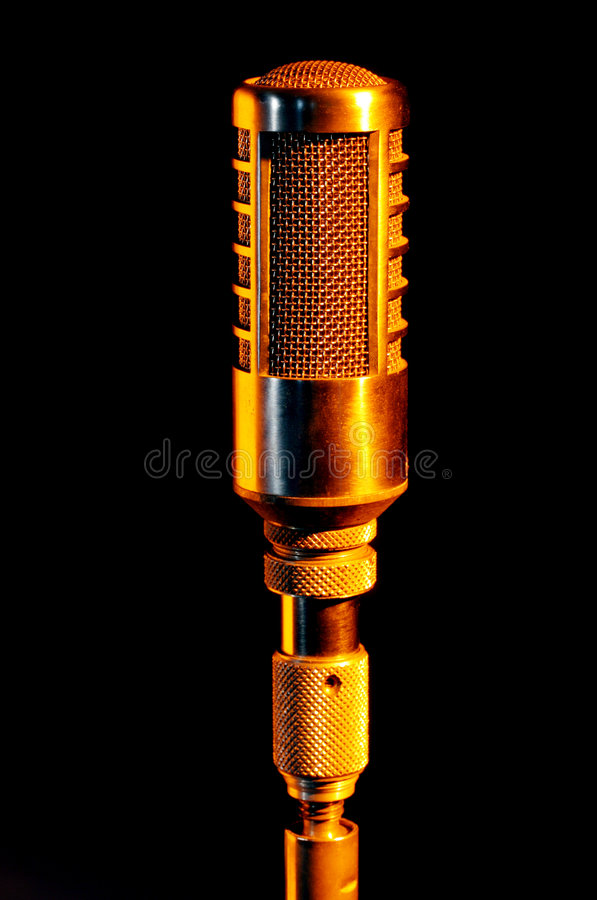 Retro gold Vocalist microphone royalty free stock images