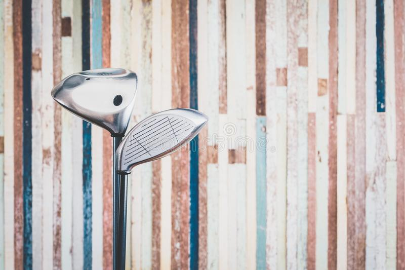 retro golf club with vintage old wooden bacground with copy space stock photo