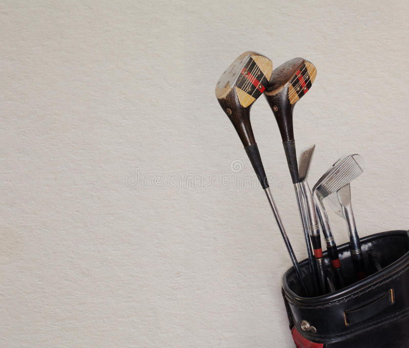 Retro golf clubs in an old leather bag, copy space royalty free stock images
