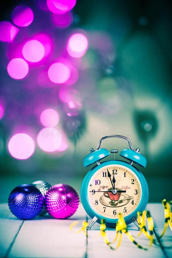 Retro green alarm clock with five minutes to midnight. royalty free stock photo