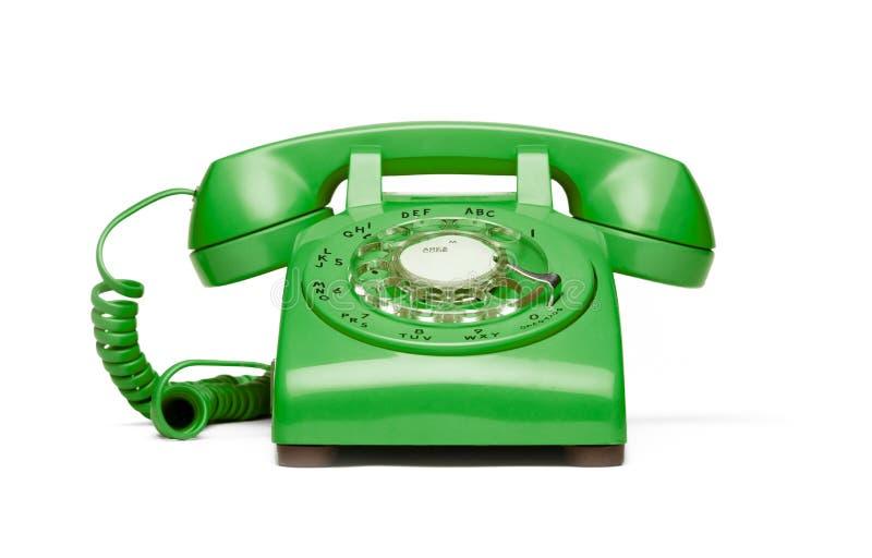 Retro groene telefoon op witte achtergrond. stock foto