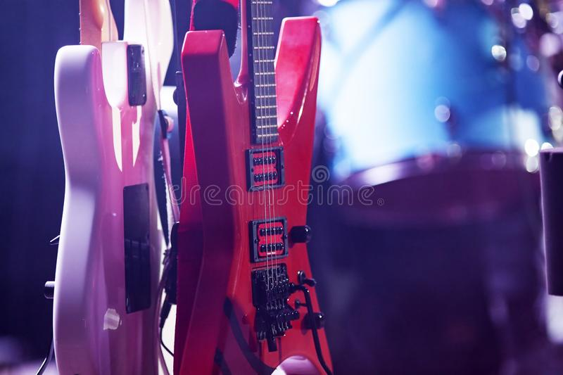 Retro guitars in stage lights. Music, rock, concert, musical, instrument, sound, vintage, entertainment, acoustic, background, electric, string, musician, band royalty free stock image