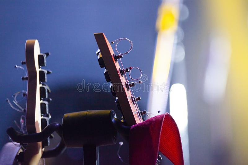 Retro guitars in stage lights. Music, rock, concert, musical, instrument, sound, vintage, entertainment, acoustic, background, electric, string, musician, band stock image