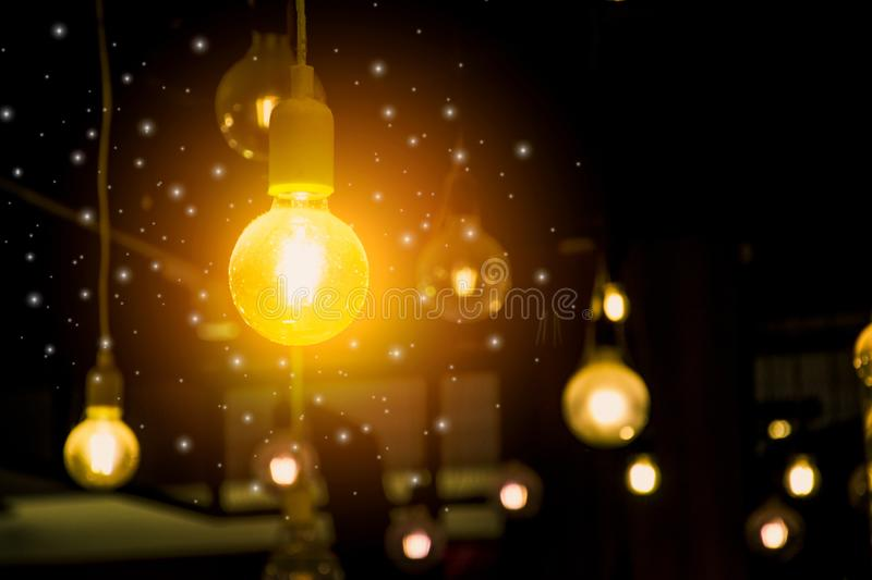 Retro hanging light bulb glowing,innovative concept development and creative of technology,design and creativity innovation,energy. Saving and renewable stock photos