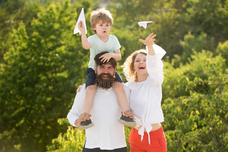 Retro hipster romantic couple in love with happy kid. Funny time. People having fun outdoors. Adopt kid. Father mother stock photo