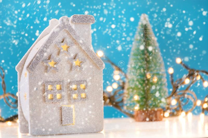 Retro house toy on winter day with snow flake and Christmas tree in background royalty free stock photos
